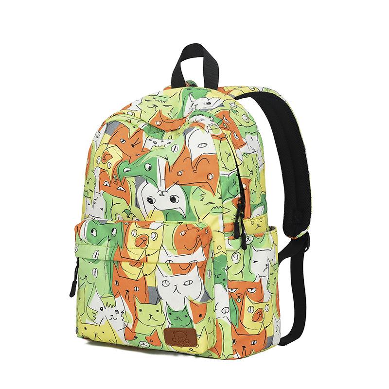 Zelený školní batoh s kočkami